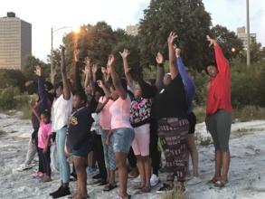 Girls practice mindfulness at sunrise