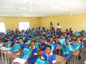 Students receiving mosquito bed nets