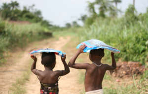 Carrying their mosquito bed nets home