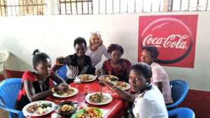 Stacy enjoys lunch with GWI's sponsored students
