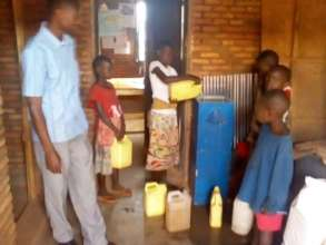 School children adding water to the filter system
