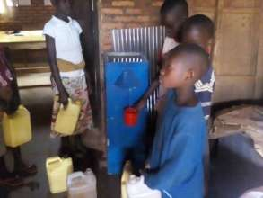 School children filling containers of clean water