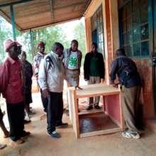 Teachers learning to build a solar dryer