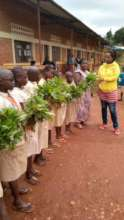 Students showcasing their harvest
