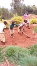 Students preparing the soil for planting