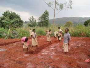 Burundian youth working in the garden