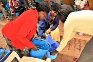 Clients and staff demonstrating water purification
