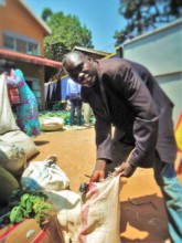 Julius packs his food to take back to his family