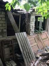 Volodymyr and Tetiana destroyed house
