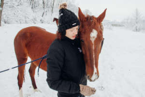 A caring touch is therapeutic for people & horses