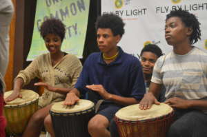 Youth drumming at the program