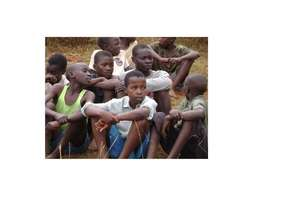 Children follow thw proceedings of sports festival