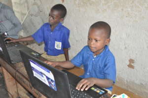 Joseph, primary four student learning how to type
