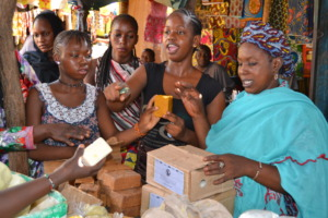 Program beneficiaries selling their soap at market