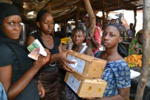 Trainees sell soap in the Bamako market