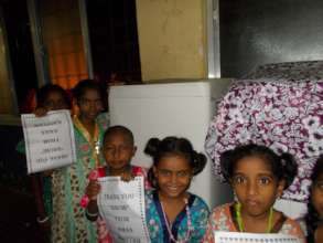 Children with the washing machine provided to home