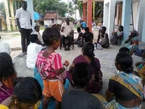 Director-HESAT-local partner explaining activities