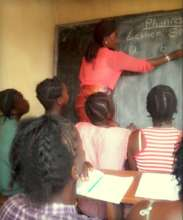 Stage 1 pupils in Makeni learning letter sounds