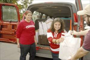 Volunteers load a delivery van.