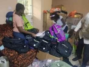 DASL team packing school supplies into book bags