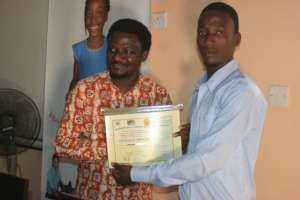Ferenkeh received his certificate of completion