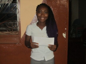 Christiana with her scholarship