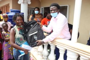 Mariama receiving her new school supplies