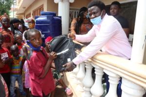Samuel receiving new school supplies