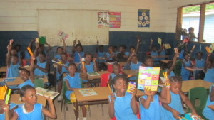 Wilma's classmates show off their supplies
