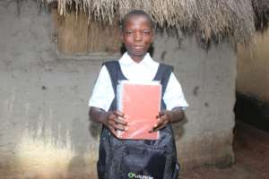 Ibrahim with his new school supplies