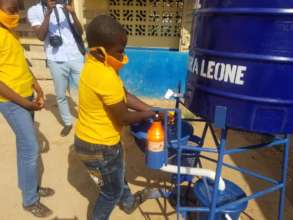 Student using the new hands-free washing station