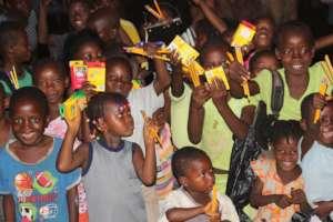 Kids holding pencils in Sierra Leone