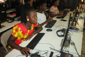 Young lady receiving computer training
