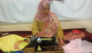 Mah Jan creating beautiful clothing.