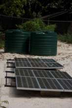The solar panels and water tanks