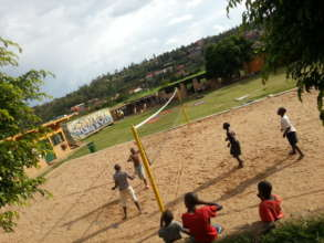 Boys Playing Beach volleyball at the center