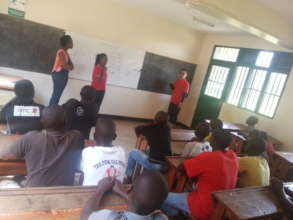 learning in Class with volunteers from IYF