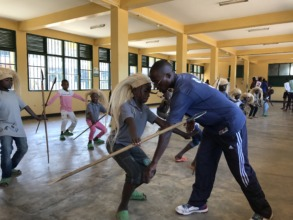 Trainer is teaching kids a traditional dance