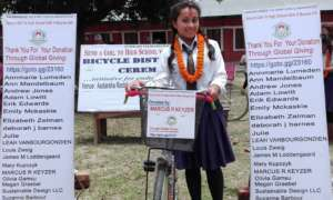 Shila 9th grader with her bicycle