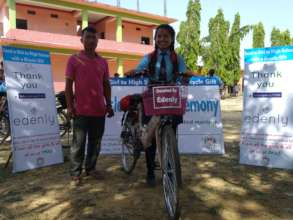 Anjali with her father after receiving the bicycle