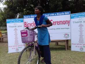 Recipient girl ready to go with the bicycle gift