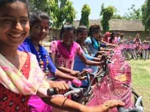 High school girls after receiving the bicycle gift