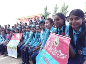 Girls acknowledging the bicycle donors