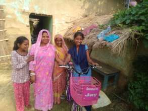 Nira with her family members at her home