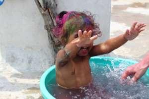 Josie splashing happily