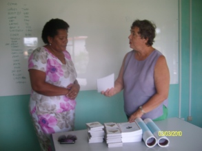 Handing over Parenting booklet in Fijian language