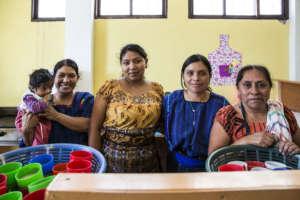 Gricelda Standing with the Preschool's Teachers