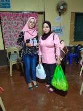 Distributing hand sanitizers to local nurses