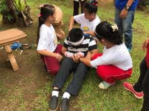 Mini-Nurses practicing earthquake response