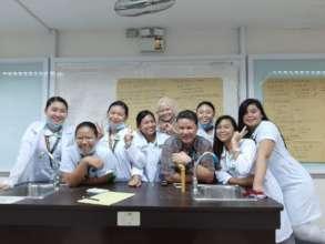 With professor in nursing school lab